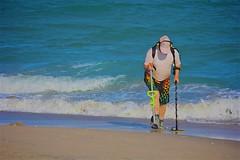 Treasure hunter (LarryJay99 ) Tags: atlanticocean beachcomber canon60d dude dudes facialhair guy guys headphones lakeworthbeach lake worth beach worthmalemanmenoceansaltwaterseashoreseasideshortsunglassestreasure hunterurban backpacker water ways