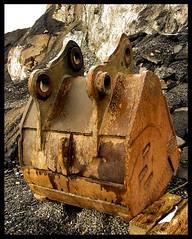 Backhoe bucket (chartan) Tags: abandoned alaska bucket rocks backhoe quarry ketchikan sealaska