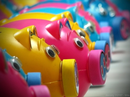 A row of colored piggy banks