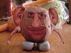 29/11/2007 (Day 364) - Kaptain Potato Head (Kaptain Kobold) Tags: selfportrait macro feet alan mouth toy nose eyes pieces arms ears vegetable potato cabbage carrot onion mrpotatohead disturbing 365 eyebrows hasbro day364 blutack kaptainkobold 365days yourfave 365thursday 3651107 365year1