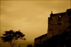 Portait of A Gloomy Day (The Wandering Angel) Tags: africa travel sky history sepia architecture interestingness ruins poetry gloomy kenya fort explore thoughts rainy mombasa fortjesus