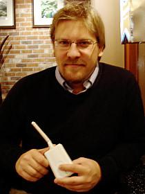Boris Mann, of Vancouver Free the Net, holding a Meraki Mini wireless transmitter.