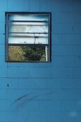 In Outside (Jobe Roco) Tags: blue window louisiana lafayette brokenglass 2007 3677 cinderblockwall cmwdblue