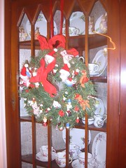 The corner cupboard in the dining room gets a wreath, too.