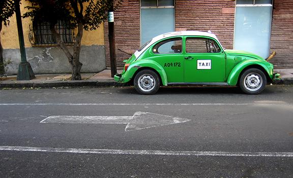 Green Volkswagen Beetle Taxi