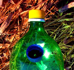 Thrown from an Observation Platform (Art and Nature-Mike Sherman) Tags: photo michigan mountpleasant illegal drug mtpleasant paraphenalia millpondpark popbottle mtpleasantparksandrecreation