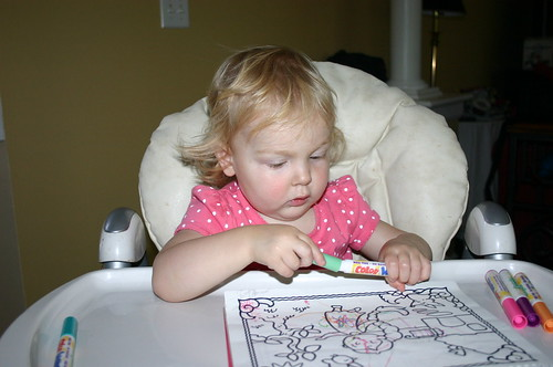 Anna coloring and putting the caps back on the markers