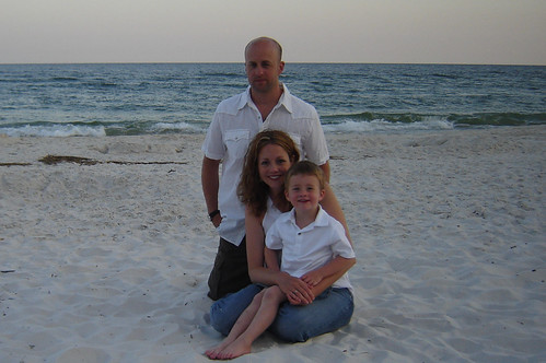 family photo with white shirts on the beach