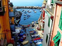 Riomaggiore, Cinque Terre (cischia) Tags: sea sky italy panorama sun beach water marina landscape boat mare liguria panoramica vista cinqueterre acqua spiaggia breathtaking riomaggiore baia 5terre 10faves
