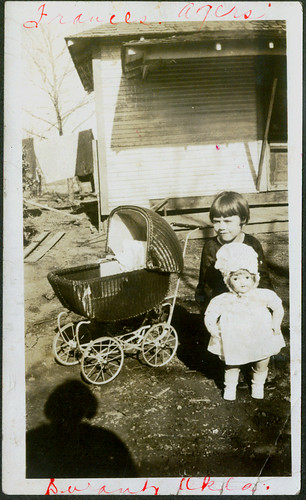 Child with buggy and doll