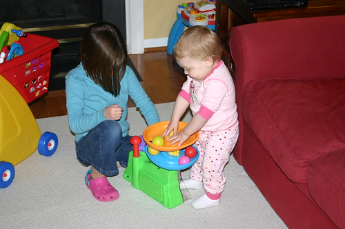 Tori and Anna playing with the ball popper