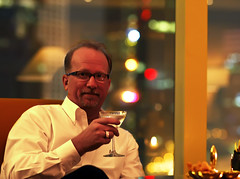 After A Grueling Day (Bill Adams) Tags: china me smiling hongkong cocktail 12months barscene billadams canonef85mmf12liiusm nopomengranite absolutcitronmartiniupshakenhardwithatwist thiswasnotapomegranatemartinithereforeicouldnothavespelleditwrong