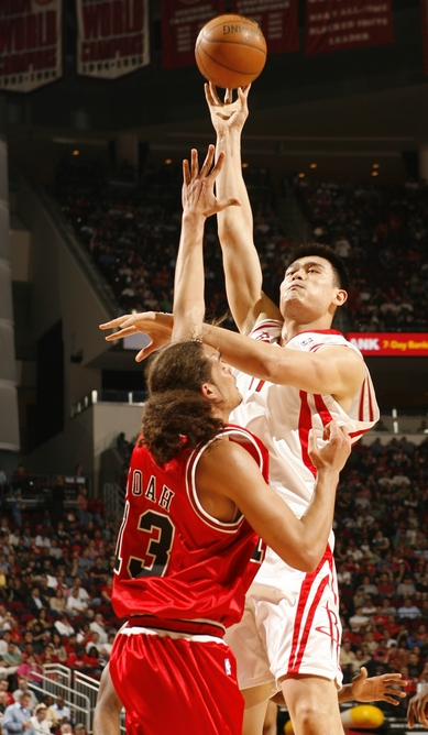 Yao Ming shoots a jump hook over Chicago rookie Joakim Noah on Sunday night to help the Rockets win their 12th game in a row, beating the Bulls 110-97.  Yao's firepower wasn't needed as much since 6 other Rocket players scored in double figures.  Yao would finish with 12 points and 6 boards.