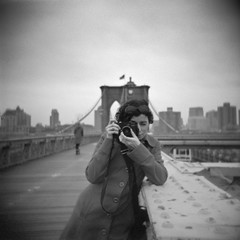 nathalie (and her leica) on the brooklyn bridge (davidteter) Tags: nyc newyorkcity bw film holga g nathalie brooklynbridge holga120n shq ilforddelta400professional nathaliefarigu