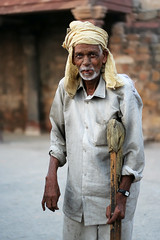 Gatekeeper at Sultangarhi Tomb (Saad.Akhtar) Tags: old portrait india history monument delhi indian ad ruin oldman medieval walkingstick historical turban 1231 watchman feeble sultana razia iltutmish southdelhi vasantkunj slavedynasty sultangarhi