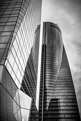 Downtown (B.B.H.70) Tags: madrid ciudad city 4torres spain españa rain lluvia andthencametherain tower building bw reflection