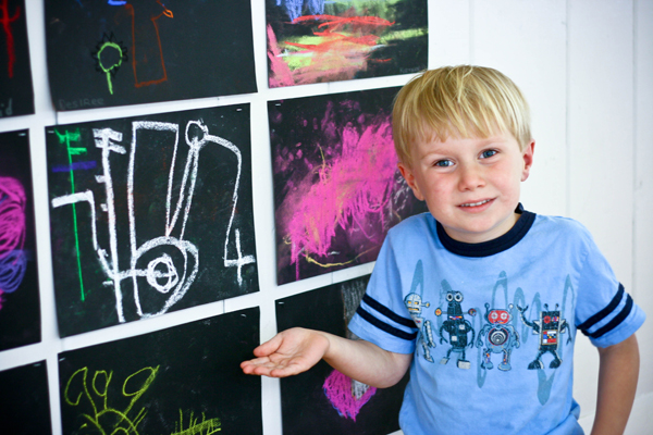 Showing off his drawing at the art show