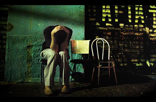 a melancholy shuffle of weariness