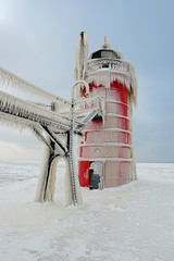 south haven light north side (Tom Gill.) Tags: winter lighthouse snow ice michigan lakemichigan explore southhaven lapstrake beautifulearth