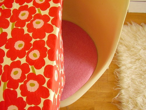 Pink upholstered Eames seat pad