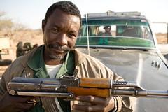 Meet The Janjaweed-18.jpg (Andrew Carter) Tags: gun fighter sudan rifle guard arab weapon conflict militia darfur ak47 janjaweed unreportedworld