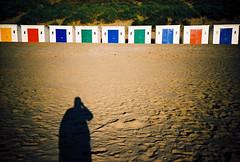 my shadow and beach huts (lomokev) Tags: blue shadow red color green beach yellow seaside lomo lca xpro lomography crossprocessed xprocess sand lomolca huts hut devon beachhut agfa jessops100asaslidefilm agfaprecisa beachhuts woolacombe lomograph agfaprecisa100 precisa deletetag jessopsslidefilm roll:name=080915lomolcaa file:name=080915lomolcaa119 woolacombebeachhut