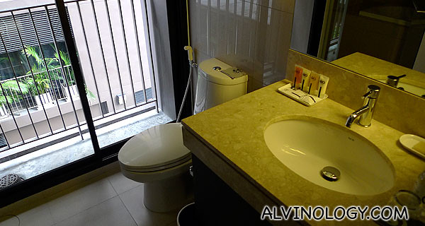 The bathroom which comes with both a bath tub and shower head