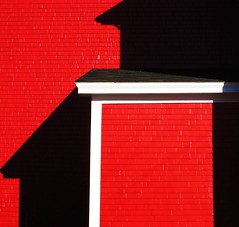 Lunenburg Red Shadows (swisscan) Tags: red house canada building nova bravo scotia lunenburg themoulinrouge 35faves 5for2 superbmasterpiece favemegroup3 diamondclassphotographer megashot superhearts colourartaward artlegacy abstractartaward theroadtoheaven thegoldendreams world100f