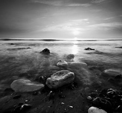 Another Planet (lowbattery) Tags: longexposure sunset sea blackandwhite white mist black water grey rocks smoke pebbles eastbourne squarecrop beachyhead birlinggap anotherplanet