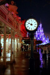 Disney - Main Street Clock at Night (Explored) (Express Monorail) Tags: street usa reflection castle clock wet colors rain geotagged interestingness orlando lowlight mainstreet colorful purple nightshot florida streetlights f14 magic main january sigma kingdom disney disneyworld handheld cinderella wdw waltdisneyworld walt 2008 themepark magickingdom giftshop waltdisney mainstreetusa wetstreet 30mm cinderellacastle flickrexplore explored disneyshop disneyparks disneyatnight nikond40 pirateandprincessparty pirateandprincess paintshopprophotox2 disneyicon disneyphotochallengewinner geo:lat=2841731 geo:lon=81581257