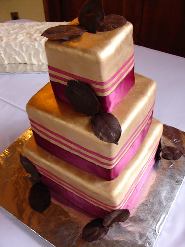 Gold wedding cake with chocolate leaves