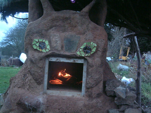 fire in the cat mud oven – cat cob sculpture – stonewill