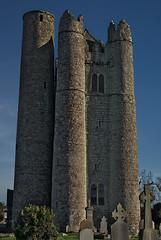 Lusk Tower (Jarl van Hoother) Tags: ireland dublin tower castle heritage church graveyard stone pentax medieval belfry pancake lusk darktower aficionados roundtower stonetower fingal roundchurchtower medievaltower k10d pentaxk10d irishroundtower justpentax 40mmlimited castlegraveyard medievaltowerdark jarlvanhoother mediaevaltower mediaevaltowers tombsingraveyardofcastle roundchurchtowerruin