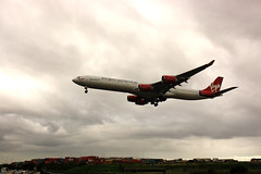 Virgin Atlantic Airbus A340-600 (HowiePoon) Tags: london plane fly airport nikon d70s sydney engine australia smith atlantic mascot virgin international 600 airbus land nikkor 340 kingsford