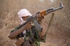Meet The Janjaweed-02.jpg (Andrew Carter) Tags: gun fighter sudan headscarf rifle arab weapon conflict militia darfur janjaweed unreportedworld