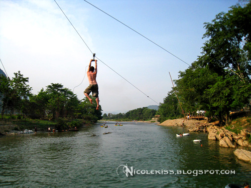 swinging into river
