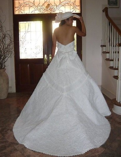 DIY TP Wedding Dress Winner The hat in the image is made out of toilet paper