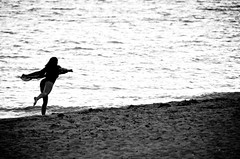 The Wind Beneath My Wings (lynn.h.armstrong) Tags: ocean camera vacation bw woman white ontario canada black art beach water girl silhouette azul lens geotagged photography photo interesting wings mac sand aperture nikon long flickr waves wind zoom south cuba may lynn h ripples iberostar laguna nikkor breeze varadero armstrong beneath stormont vr afs gettyimages dx sault ingleside 2011 ifed 18200mm f3556 attributionnoderivs vrii d7000 ccbynd lynnharmstrong requesttolicence