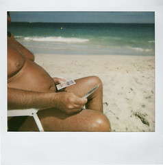 Sun tan (sengsta) Tags: ocean portrait brown beach polaroid chair russell suntan tanning sunbathe oap coogeebeach polaroidspectraonyx
