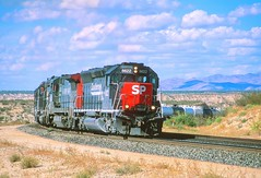 Southern Pacific SD-45E locomotive 8622 leads an eastbound freight train through Cochise County, Arizona, near Sybil, on the Sunset Route from California to the east, 1998 (full-res file) (Ivan S. Abrams) Tags: arizona ivan trains sp getty freighttrains abrams cochise railways sonorandesert gettyimages railroads nikonn90s wyattearp southernpacific smrgsbord tucsonarizona arizonadesert sd45 cochisecounty 12608 sprr americanrailroads onlythe onlythebestare bestare sd45e ivansabrams trainplanepro pimacountyarizona safyan arizonabar arizonaphotographers ivanabrams mountainrailroads trancontinentalrailroad railroadsoftheamericansouthwest desertrailroads geronmio cochisecountyarizona tucson3985 gettyimagesandtheflickrcollection copyrightivansabramsallrightsreservedunauthorizeduseofthisimageisprohibited tucson3985gmailcom ivansafyanabrams arizonalawyers statebarofarizona californialawyers copyrightivansafyanabrams2009allrightsreservedunauthorizeduseprohibitedbylawpropertyofivansafyanabrams unauthorizeduseconstitutestheft thisphotographwasmadebyivansafyanabramswhoretainsallrightstheretoc2009ivansafyanabrams abramsandmcdanielinternationallawandeconomicdiplomacy ivansabramsarizonaattorney ivansabramsbauniversityofpittsburghjduniversityofpittsburghllmuniversityofarizonainternationallawyer