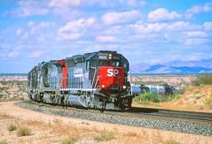 Southern Pacific SD-45E locomotive 8622 leads an eastbound freight train through Cochise County, Arizona, near Sybil, on the Sunset Route from California to the east, 1998 (full-res file) (Ivan S. Abrams) Tags: arizona ivan trains sp getty freighttrains abrams cochise railways sonorandesert gettyimages railroads nikonn90s wyattearp southernpacific smörgåsbord tucsonarizona arizonadesert sd45 cochisecounty 12608 sprr americanrailroads onlythe onlythebestare bestare sd45e ivansabrams trainplanepro pimacountyarizona safyan arizonabar arizonaphotographers ivanabrams mountainrailroads trancontinentalrailroad railroadsoftheamericansouthwest desertrailroads geronmio cochisecountyarizona tucson3985 gettyimagesandtheflickrcollection copyrightivansabramsallrightsreservedunauthorizeduseofthisimageisprohibited tucson3985gmailcom ivansafyanabrams arizonalawyers statebarofarizona californialawyers copyrightivansafyanabrams2009allrightsreservedunauthorizeduseprohibitedbylawpropertyofivansafyanabrams unauthorizeduseconstitutestheft thisphotographwasmadebyivansafyanabramswhoretainsallrightstheretoc2009ivansafyanabrams abramsandmcdanielinternationallawandeconomicdiplomacy ivansabramsarizonaattorney ivansabramsbauniversityofpittsburghjduniversityofpittsburghllmuniversityofarizonainternationallawyer