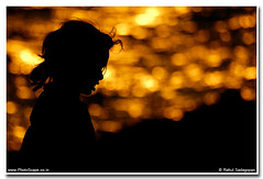 Goldilocks! (Rahul Sadagopan) Tags: sunset sea portrait woman sun india beach water girl silhouette glitter gold golden nikon waves bokeh indian south d70s 50mmf18d silhoutte kanyakumari southindian rahulsadagopan dsc9472