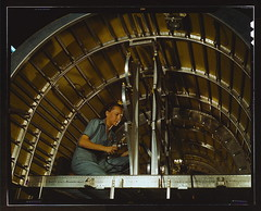 Production of B-24 bombers and C-87 transports, Consolidated Aircraft Corp., Fort Worth, Texas. Cabbie Coleman, former housewife, works at western aircraft plant. Installing of oxygen racks above the flight deck  (LOC)