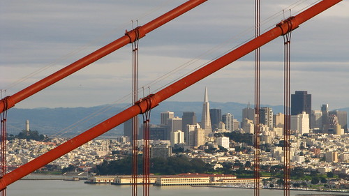 San Francisco skyline through the Golden Gate Bridge by scrunchy17.