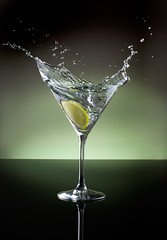 Martini glass no. 2 - Vodka and a splash of lime (Bald Monk) Tags: light food black reflection green robert glass photography photographer bald martini monk rob reflect booze vodka lime martiniglass splash tunstall bhcc strobist