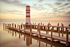 For We All Need a Lighthouse (TomOnTheRoof) Tags: longexposure lighthouse lake reflection horizontal composition outdoors pier dusk peaceful diagonal explore direction strong 1000v100f topf200 neusiedlersee podersdorf tomanthony impressedbeauty tomontheroof