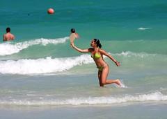 Frescobol at the waves on Miami's South Beach (Ricardo Carreon) Tags: people woman usa playing game praia beach girl topv2222 ball mujer women miami topv1111 mulher topv999 playa bikini topv777 fl swimsuit topv3333 topv666 southbeach bathingsuit sobe topv888 biquini paddleball frescobol rubyphotographer