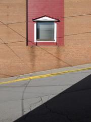 A view out to a slanted street from a window of venetian blinds. (Tim Kiser) Tags: 2014 20141226 chestnutstreet december december2014 img4930 monongaliacounty monongaliacountywestvirginia morgantown morgantownwestvirginia westvirginia westvirginiajuniorcollege westvirginiajuniorcollegeatmorgantown westvirginiajuniorcollege—morgantown brickbuilding brickwall building cinderblockwall concreteblockwall crackedpavement cracksinpavement curb darkredpaint downtown downtownmorgantown electricline electriclineshadows hillside hillsidearchitecture hillsidebuilding hillsidestreet juniorcollege kerb paintedcinderblocks paintedconcreteblocks paved pavement pediment powerline powerlineshadows slopingstreet stainedbricks stainedmortar steeproad steepstreet venetianblind venetianblinds window windowblind windowblinds windowpediment yellowcurb unitedstates