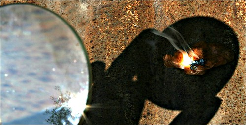 a demo of archimedes death ray using magnifying glass