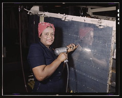 "Operating a hand drill at Vultee-Nashville, woman is working on a ""Vengeance"" dive bomber, Tennessee  (LOC) (The Library of Congress) Tags: woman black industry smile plane vintage airplane glamour women war nashville tennessee rosietheriveter aviation military rosie wwii slidefilm worldwarii 1940s rights transparency overalls ww2 africanamerican 4x5 lf worker libraryofcongress february bandana bomber largeformat drill wecandoit worldwar2 1943 a31 wartime poc transparencies vengeance womensday manufacturing nashvilletn divebomber workforce vultee historicalphotographs february1943 iwd davidsoncounty wareffort riviter xmlns:dc=httppurlorgdcelements11 dc:identifier=httphdllocgovlocpnpfsac1a35373 alfredtpalmer vulteeaircraftincorporated alfredpalmer divebomberassembly vengeancebomberassembly womanoperatingrivetgun joyofthechallenge vulteeaircraftcorporation vulteeaircraft posiveblackwoman vulteevengeance vulteenashville"